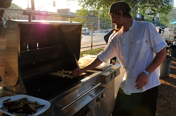 Brian from Frontera Grill grilling corn cakes on the Kalamazoo